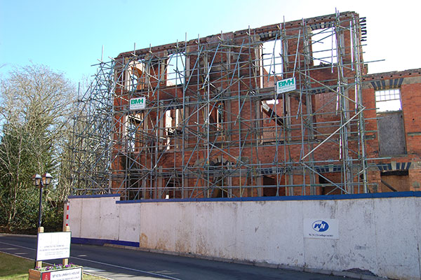 Partially demolished building with scaffolding